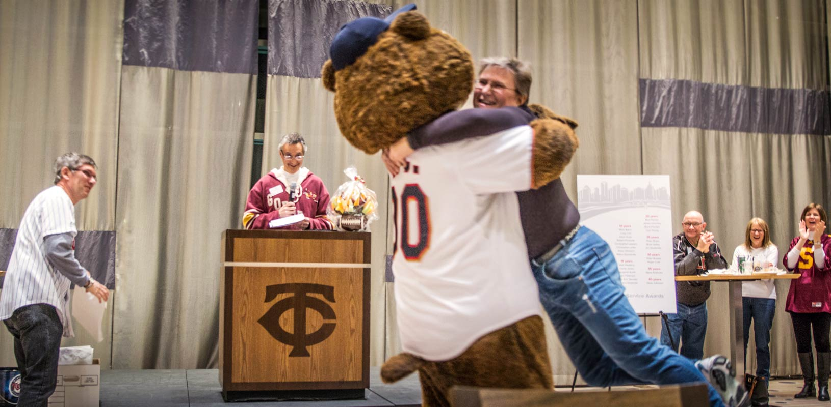 Twins TC Bear gives TKDA employee a hug