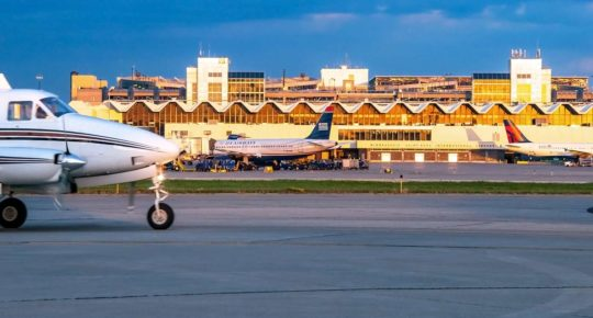 Photo of small and large planes at MSP airport