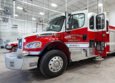 A close up of a fire truck inside the Superior Fire Station.
